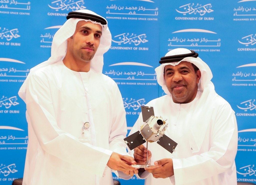 Ahmad Al Haddabi, Chief Operations Officer at Abu Dhabi Airports, and Salem Humaid Al Marri, Assistant Director General for Scientific and Technical Affairs at MBRSC, pose for a picture after signing a Memorandum of Understanding