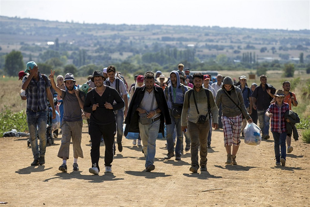 Migrants from Syria walk along a road near the town of Presevo, Serbia Photo credit: Reuters/Marko Djurica
