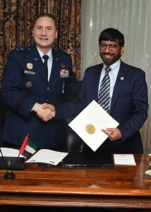 Major General Clinton E. Crosier, U.S. Air Force, Director of Plans and Policy at U.S. Strategic Command, and His Excellency Dr. Khalifa Al Romaithi, Chairman of the UAE Space Agency, shake hands after signing an MoU committing both sides to sharing space situational awareness data. Photograph by Senior Airman William Branch, courtesy of the U.S. Air Force.