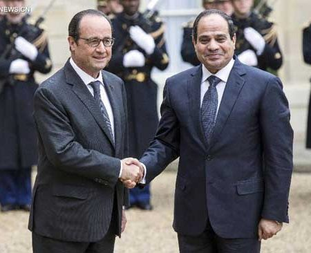 French President Francois Hollande greets Egyptian President Abdel Fattah al-Sisi at the Elysee Palace in Paris, France, on 26 November 2014. Photograph courtesy of Xinhua.