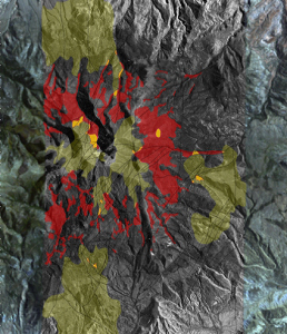 The 3-D Bare Rock Model© classifies satellite data to differentiate rock and formation types. This mineral classification map shows areas containing high concentrations of copper (red) and feldspar (green). Locations of spatial correlation of copper and feldspar are identified (yellow) prospective targets. Image produced by Auracle Remote Sensing.