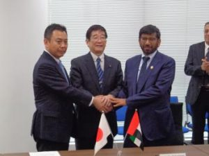 H.E. Dr. Khalifa Al Romaithi, Chairman of the UAE Space Agency, shakes hands with Japanese ministers after signing the UAE-Japanese space Memorandum of Cooperation. Photograph courtesy of the UAE Space Agency.