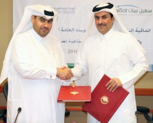 Es'hailSat's President and Chief Executive Officer, Mr. Ali Ahmed Al Kuwari, and QCAA's Chairman Mr. Abdulla Nasser Al Subaey, exchange copies of their MoU to cooperate on building Earth observation satellites. Photograph courtesy of Es'hailSat.