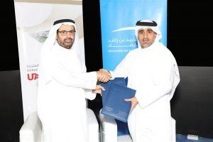 H.E. Dr. Ali Rashid Al Noaimi, Vice Chancellor of UAEU, and H.E. Hamad Obaid Al Mansoori, Chairman of the Board of Directors at MBRSC, shake hands. Photograph courtesy of the Mohammed bin Rashid Space Centre.