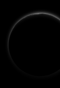 The Dark Side of Pluto: NASA's New Horizons spacecraft took this stunning image of Pluto only a few minutes after closest approach on July 14, 2015. The image was obtained at a high phase angle –that is, with the sun on the other side of Pluto, as viewed by New Horizons. Seen here, sunlight filters through and illuminates Pluto's complex atmospheric haze layers. Photograph courtesy of NASA.
