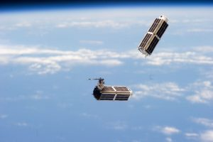 Dove earth observation satellites, built by Planet, launched from the International Space Station. Photograph courtesy of Planet.