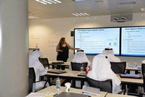 Amal Ezzeddine, Senior Director for Government and Corporate Affairs, lectures at Lockheed Martin's Center for Innovation and Security Solutions in Masdar City, United Arab Emirates. Photograph courtesy of Thuraya.