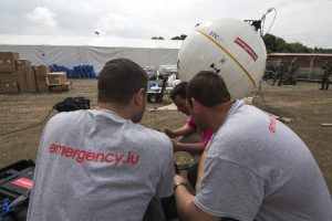 Aid workers installing a satellite communications terminal in Kathmandu, Nepal. Photograph courtesy of SES.