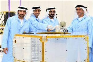 H.H. Sheikh Mohammed bin Rashid Al Maktoum examines KhalifaSat at the Mohammed Bin Rashid Space Centre in Dubai.
