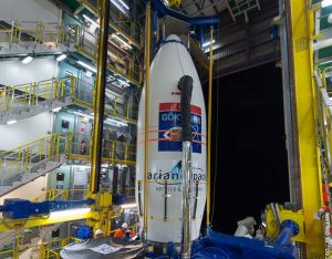 Ahead of its launcher integration, GÖKTÜRK-1 is hoisted to the upper level of the Vega launch site's mobile gantry ; Credits: Arianespace
